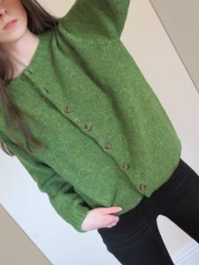 Girl wearing luxury green merino cardigan